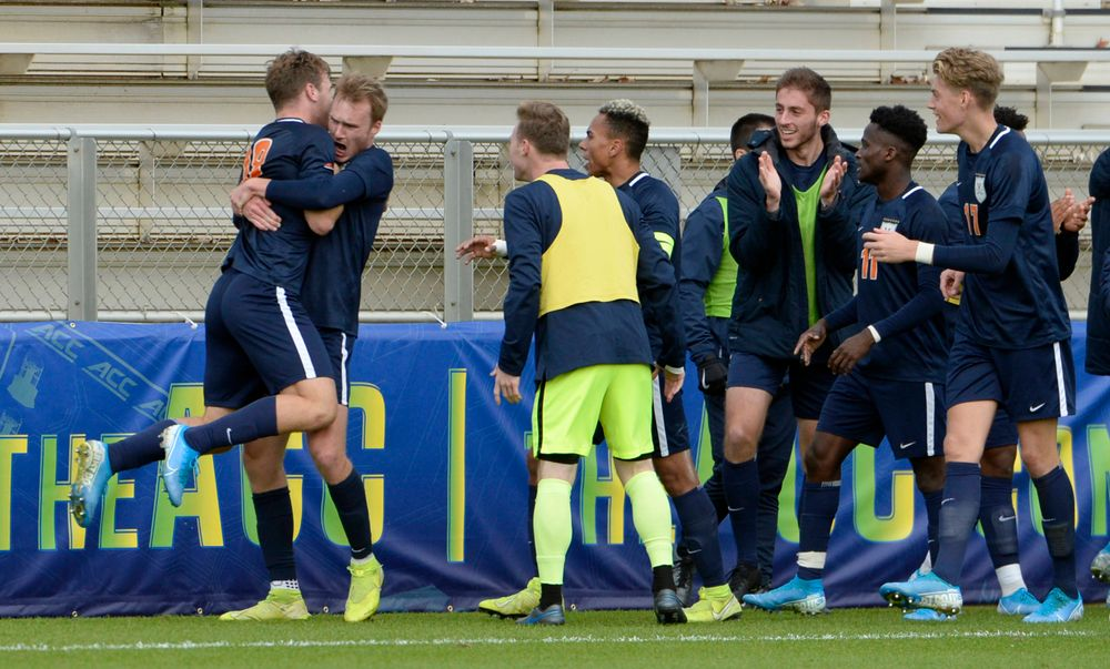 Virginia's Henry Kessler (5) hugs Virginia's Axel Gunnarsson (18) after Gunnarsson?s goal during the 2019 ACC Men?s Soccer Championship at WakeMed Soccer Park in Cary, N.C., Sunday Nov. 17, 2019. (Photo by Sara D. Davis, the ACC)