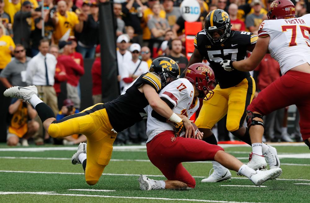 Iowa Hawkeyes linebacker Nick Niemann (49) sacks Iowa State Cyclones quarterback Kyle Kempt (17) Saturday, September 8, 2018 at Kinnick Stadium. (Brian Ray/hawkeyesports.com)