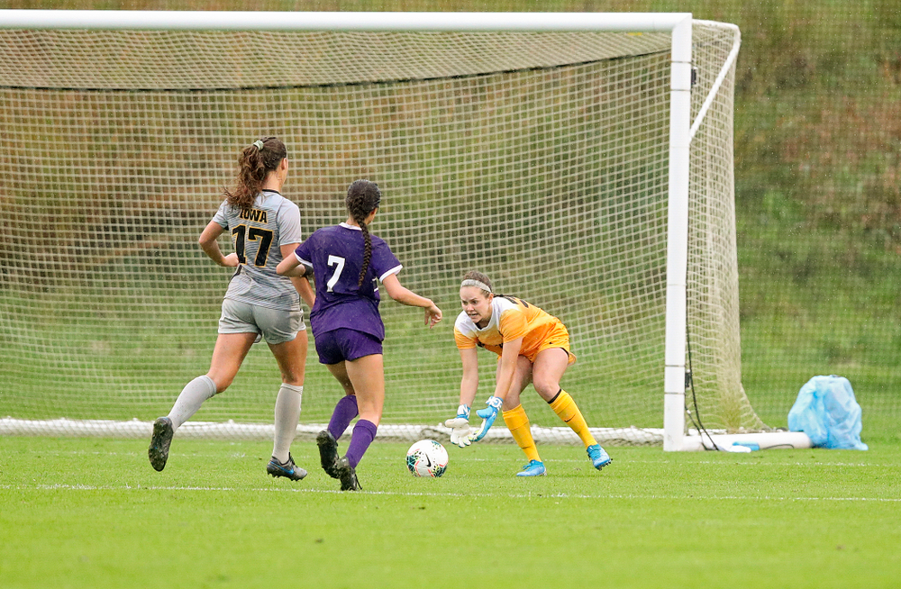 Iowa goalkeeper Claire Graves (34) scoops up a shot as defender Hannah Drkulec (17) closes in during the second half of their match at the Iowa Soccer Complex in Iowa City on Sunday, Sep 29, 2019. (Stephen Mally/hawkeyesports.com)