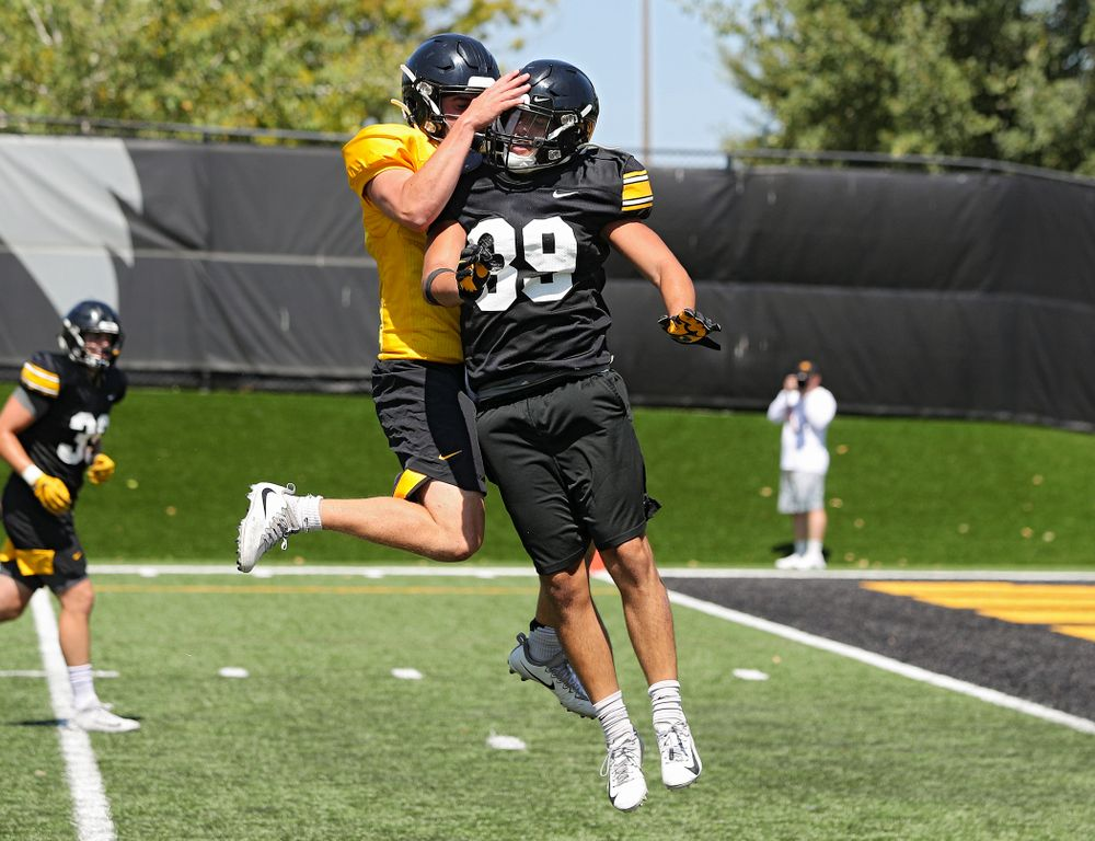 Iowa Hawkeyes quarterback Peyton Mansell (2) celebrates with wide receiver Nico Ragaini (89) after throwing him a touchdown pass during Fall Camp Practice No. 7 at the Hansen Football Performance Center in Iowa City on Friday, Aug 9, 2019. (Stephen Mally/hawkeyesports.com)