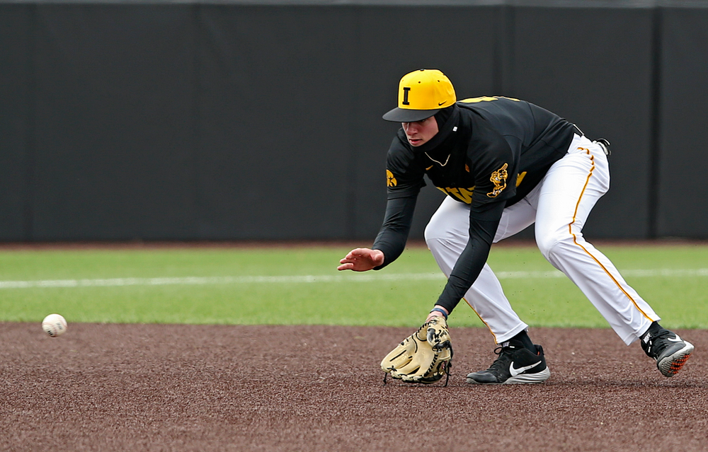 Iowa Hawkeyes third baseman infielder Brendan Sher (2) fields a ground ball during the first inning of their game against Illinois at Duane Banks Field in Iowa City on Saturday, Mar. 30, 2019. (Stephen Mally/hawkeyesports.com)
