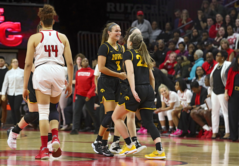 Iowa guard Makenzie Meyer (3) celebrates with guard Kathleen Doyle (22) after making a 3-pointer during the fourth quarter of their game at the Rutgers Athletic Center in Piscataway, N.J. on Sunday, March 1, 2020. (Stephen Mally/hawkeyesports.com)