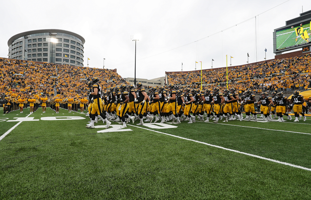 The Hawkeyes swarm as they take the field before their game at Kinnick Stadium in Iowa City on Saturday, Sep 28, 2019. (Stephen Mally/hawkeyesports.com)