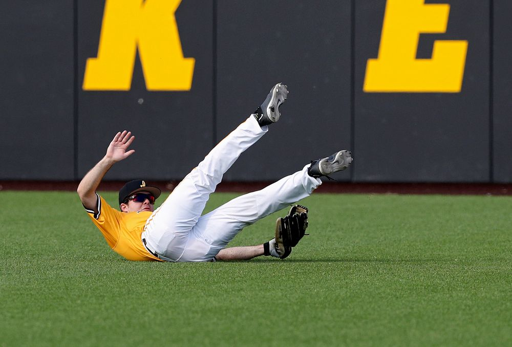 Iowa Hawkeyes right fielder Luke Farley (8) hangs onto the ball as he makes a diving catch for an out during the third inning of their game against Northern Illinois at Duane Banks Field in Iowa City on Tuesday, Apr. 16, 2019. (Stephen Mally/hawkeyesports.com)