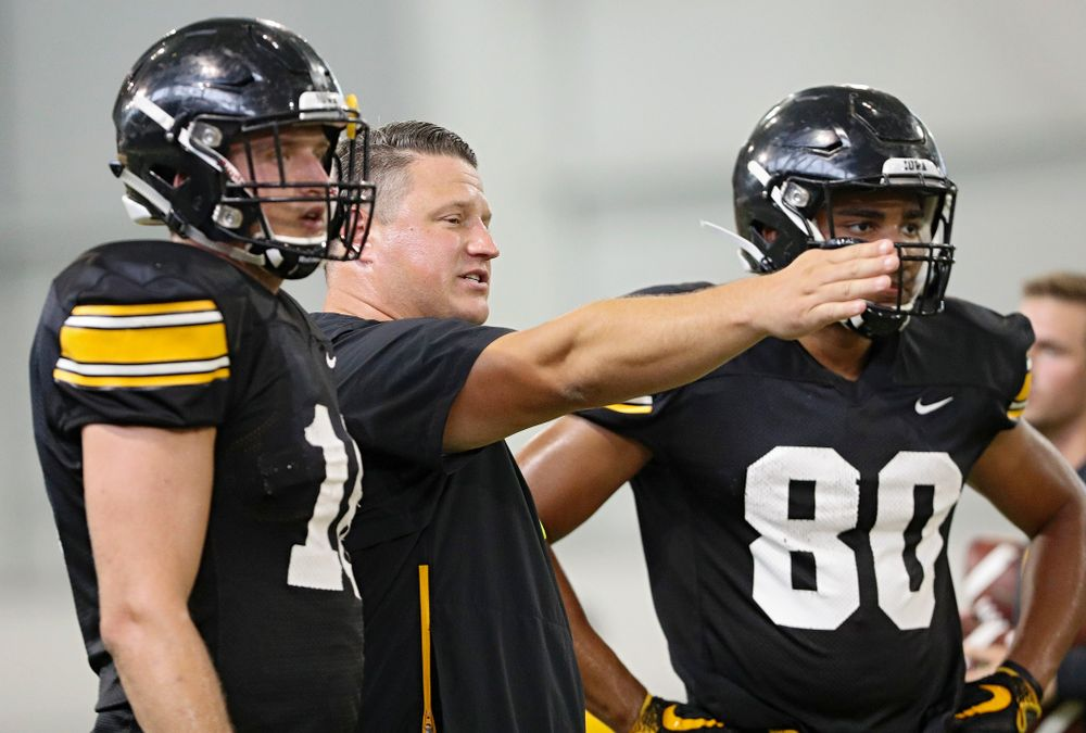 Iowa Hawkeyes offensive coordinator Brian Ferentz  (center) talks with tight end Drew Cook (left) and tight end Josiah Miamen (right) during Fall Camp Practice No. 6 at the Hansen Football Performance Center in Iowa City on Thursday, Aug 8, 2019. (Stephen Mally/hawkeyesports.com)