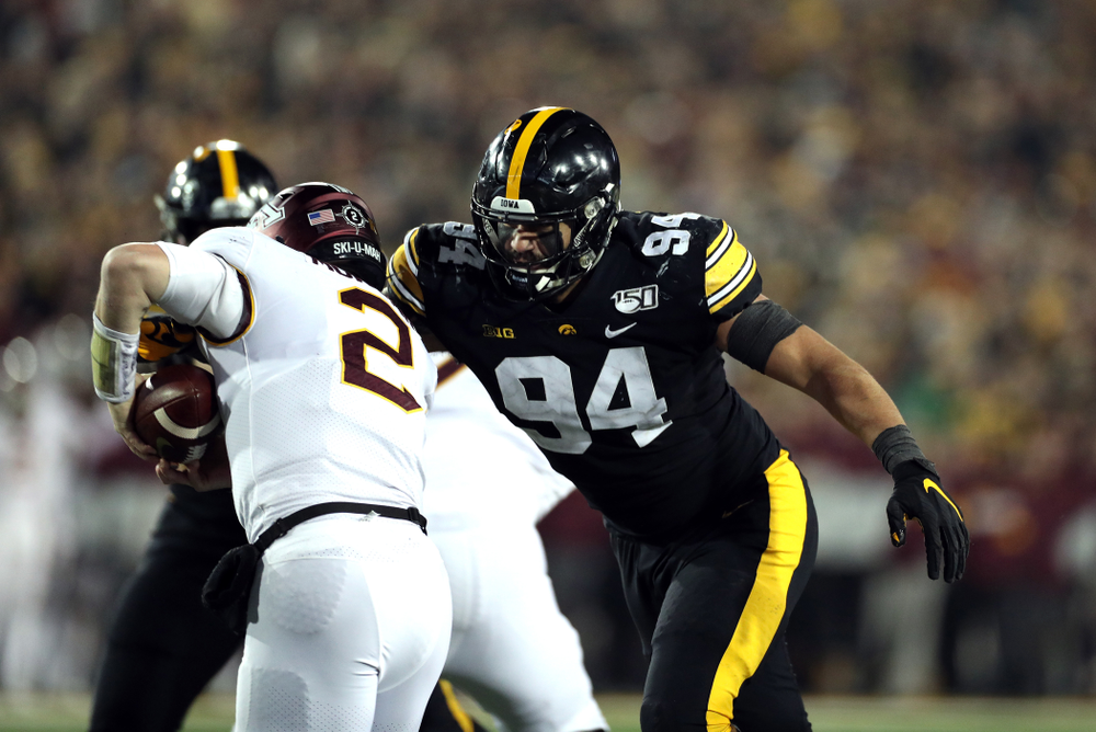 Iowa Hawkeyes defensive end A.J. Epenesa (94) records a sack against the Minnesota Golden Gophers Saturday, November 16, 2019 at Kinnick Stadium. (Brian Ray/hawkeyesports.com)