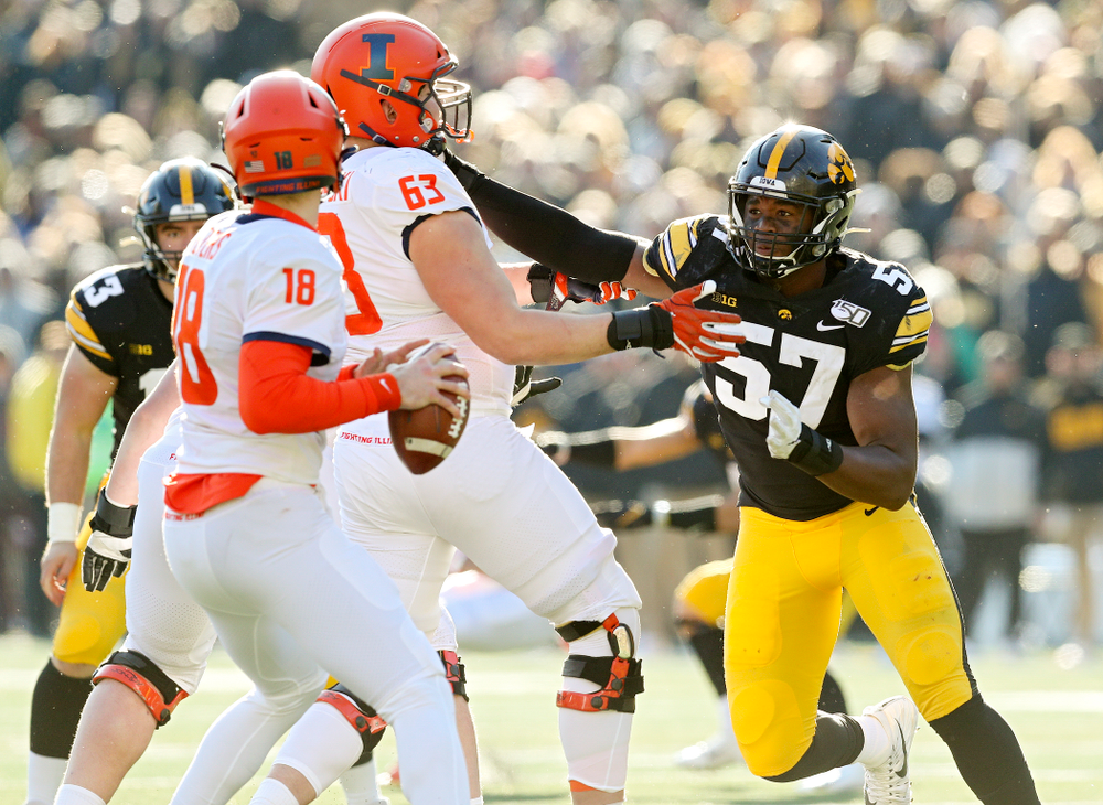 Iowa Hawkeyes defensive end Chauncey Golston (57) closes in on Illinois Fighting Illini quarterback Brandon Peters (18) during the fourth quarter of their game at Kinnick Stadium in Iowa City on Saturday, Nov 23, 2019. (Stephen Mally/hawkeyesports.com)