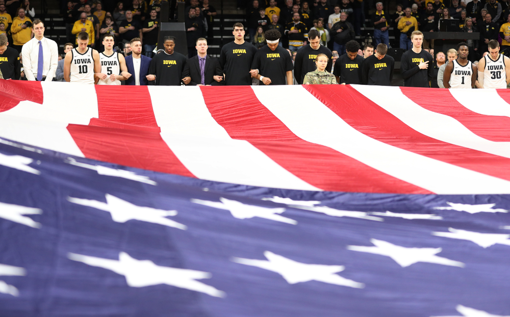 The Iowa Hawkeyes as members of the Iowa Army ROTC display a large American flag before their game against Penn State Saturday, February 29, 2020 at Carver-Hawkeye Arena. (Brian Ray/hawkeyesports.com)