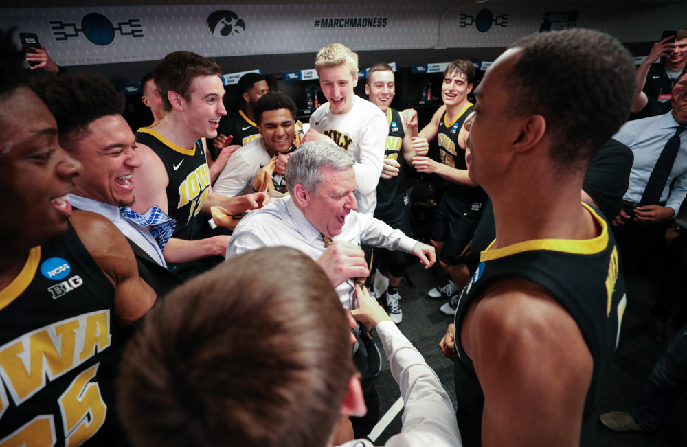 Iowa Hawkeyes assistant coach Kirk Speraw dances with the team following their win against the Cincinnati Bearcats in the first round of the 2019 NCAA Men's Basketball Tournament Friday, March 22, 2019 at Nationwide Arena in Columbus, Ohio. (Brian Ray/hawkeyesports.com)