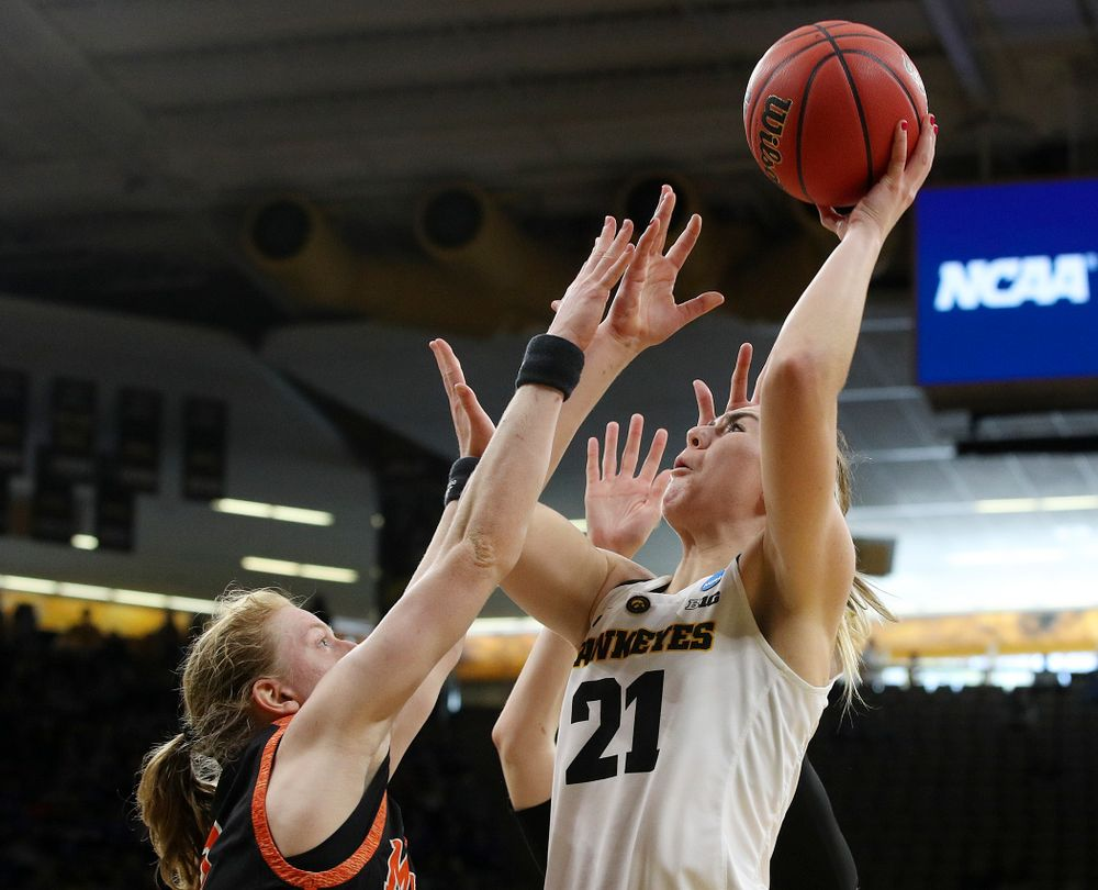 Iowa Hawkeyes forward Hannah Stewart (21) shoots during the first round of the 2019 NCAA Women's Basketball Tournament at Carver Hawkeye Arena in Iowa City on Friday, Mar. 22, 2019. (Stephen Mally for hawkeyesports.com)