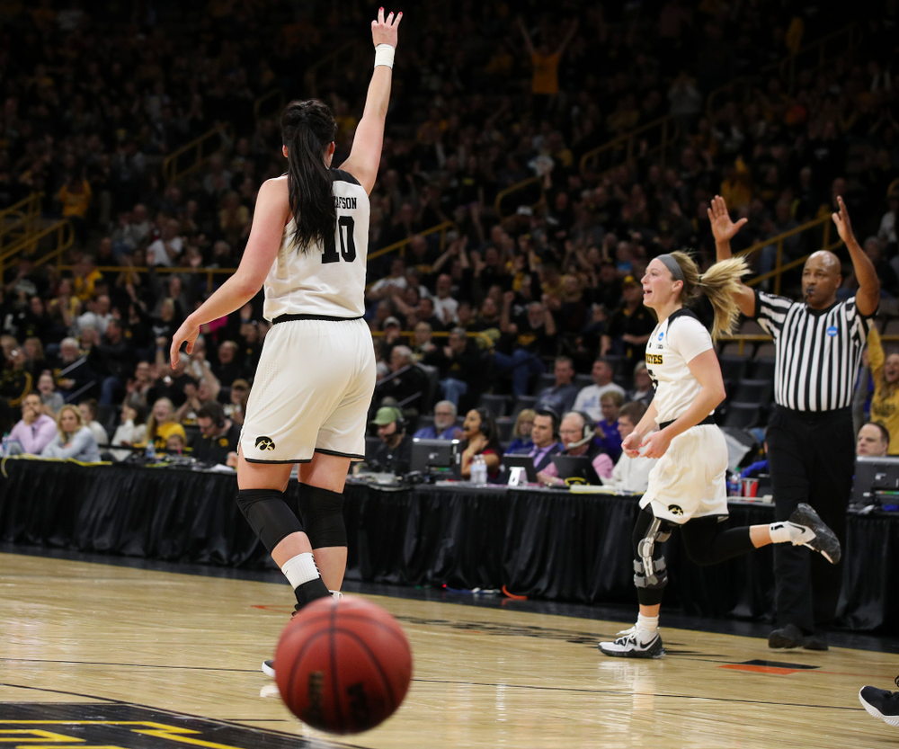 Iowa Hawkeyes forward Megan Gustafson (10) holds up three fingers after guard Makenzie Meyer (3) made a 3-pointer just before halftime during the first round of the 2019 NCAA Women's Basketball Tournament at Carver Hawkeye Arena in Iowa City on Friday, Mar. 22, 2019. (Stephen Mally for hawkeyesports.com)