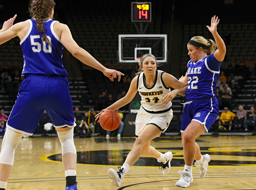 Iowa Hawkeyes guard Mckenna Warnock (14) drives with the ball during the first quarter of their game at Carver-Hawkeye Arena in Iowa City on Saturday, December 21, 2019. (Stephen Mally/hawkeyesports.com)