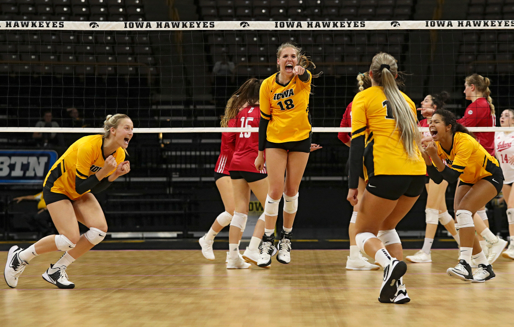 Iowa's Kyndra Hansen (8), Hannah Clayton (18), Maddie Slagle (15), and Brie Orr (7) celebrate a score during their match at Carver-Hawkeye Arena in Iowa City on Sunday, Oct 20, 2019. (Stephen Mally/hawkeyesports.com)