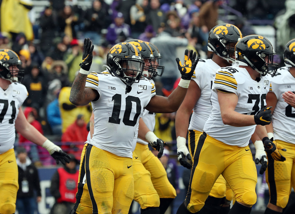 Iowa Hawkeyes running back Mekhi Sargent (10) celebrates a touchdown against the Northwestern Wildcats Saturday, October 26, 2019 at Ryan Field in Evanston, Ill. (Brian Ray/hawkeyesports.com)