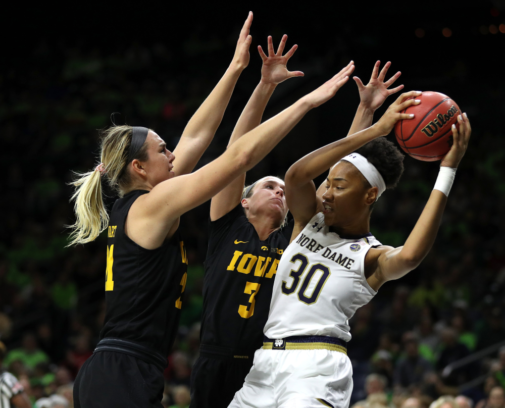 Iowa Hawkeyes forward Hannah Stewart (21) and guard Makenzie Meyer (3) against the Notre Dame Fighting Irish Thursday, November 29, 2018 at the Joyce Center in South Bend, Ind. (Brian Ray/hawkeyesports.com)