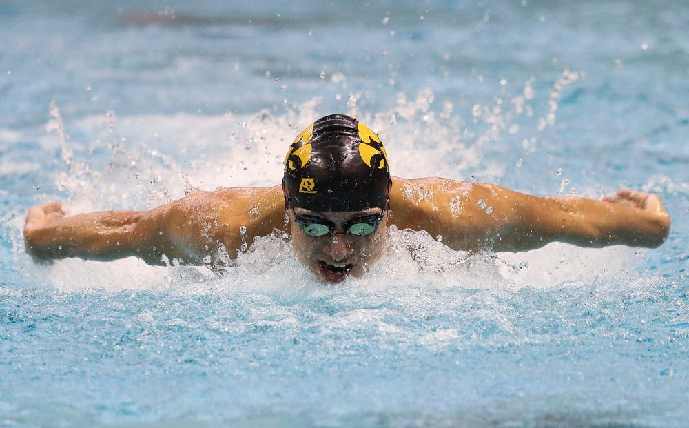 Iowa's Michael Tenney competes in the 100-yard butterfly during a meet against Michigan and Denver at the Campus Recreation and Wellness Center on November 3, 2018. (Tork Mason/hawkeyesports.com)