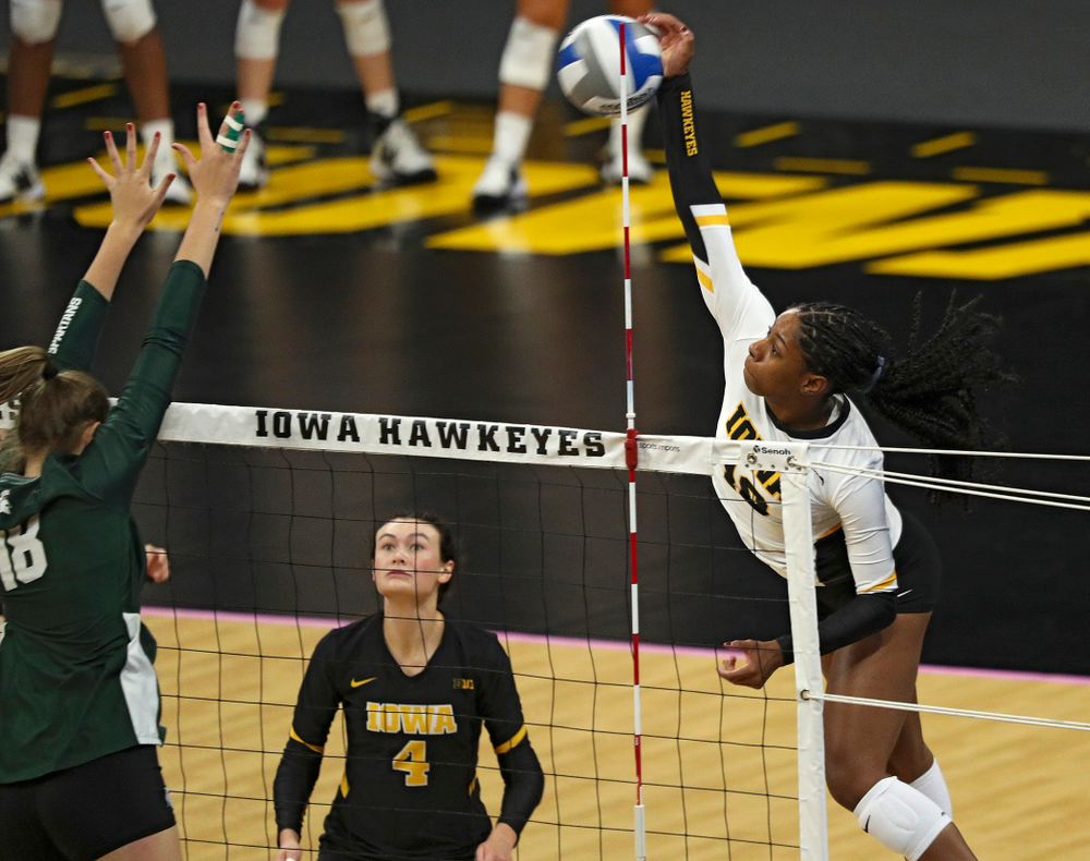 Iowa's Griere Hughes (10) gets a kill during the first set of their volleyball match at Carver-Hawkeye Arena in Iowa City on Sunday, Oct 13, 2019. (Stephen Mally/hawkeyesports.com)