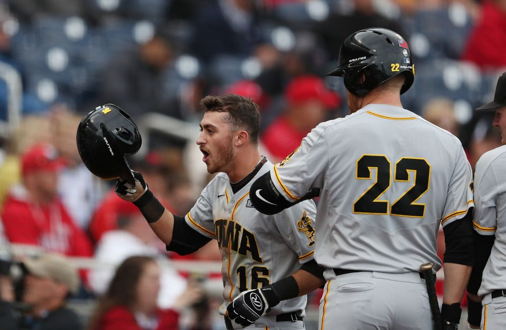 Iowa Hawkeyes Tanner Wetrich (16) celebrates after scoring against the Indiana Hoosiers in the first round of the Big Ten Baseball Tournament Wednesday, May 22, 2019 at TD Ameritrade Park in Omaha, Neb. (Brian Ray/hawkeyesports.com)