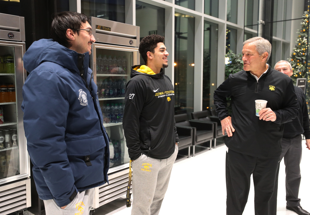 Iowa Hawkeyes head coach Kirk Ferentz talks with place kicker Miguel Recinos (91) and defensive back Amani Hooker (27) about the Hawkeyes selection to face Mississippi State in the Outback Bowl Sunday, December 2, 2018 at the Hansen Football Performance Center. (Brian Ray/hawkeyesports.com)