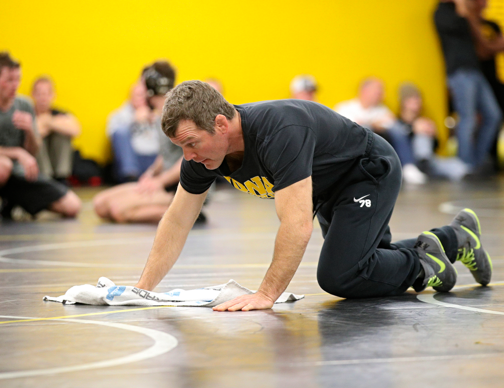 Iowa head coach Tom Brands wipes the mat before their preseason match at the Dan Gable Wrestling Complex at Carver-Hawkeye Arena in Iowa City on Thursday, Nov 7, 2019. (Stephen Mally/hawkeyesports.com)
