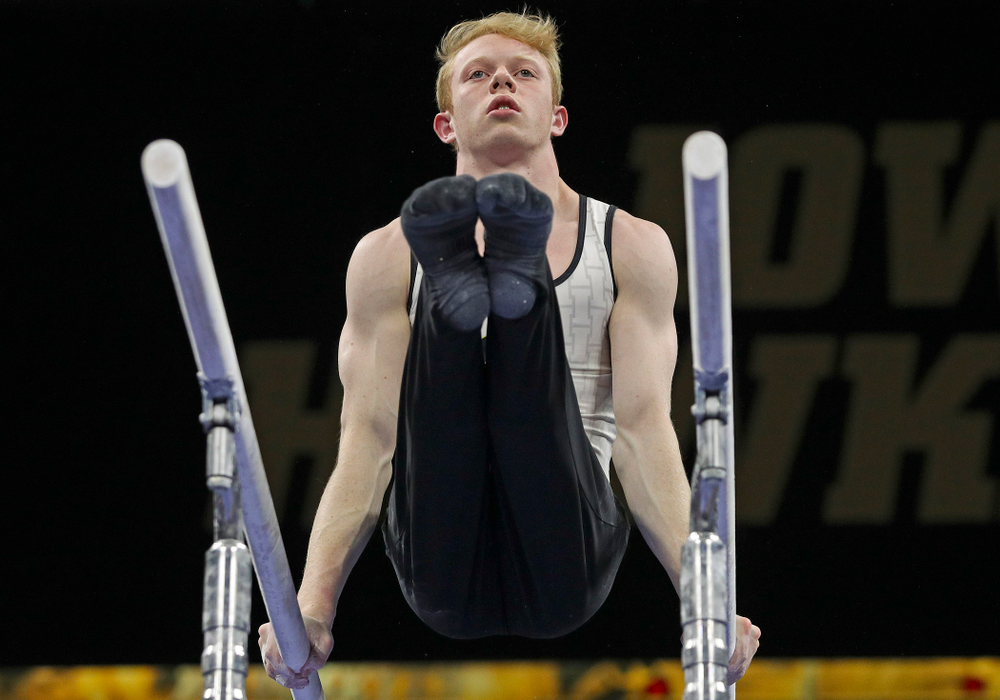 Iowa's Nick Merryman competes in the parallel bars during the second day of the Big Ten Men's Gymnastics Championships at Carver-Hawkeye Arena in Iowa City on Saturday, Apr. 6, 2019. (Stephen Mally/hawkeyesports.com)
