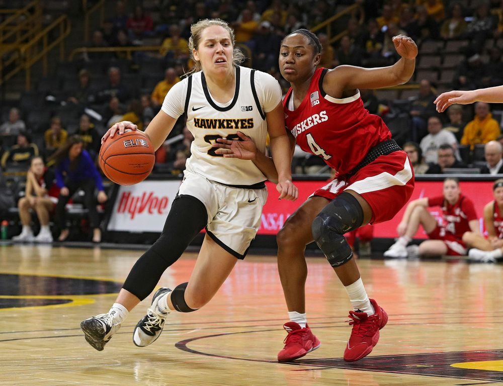 Iowa Hawkeyes guard Kathleen Doyle (22) drives with the ball during the third quarter of the game at Carver-Hawkeye Arena in Iowa City on Thursday, February 6, 2020. (Stephen Mally/hawkeyesports.com)