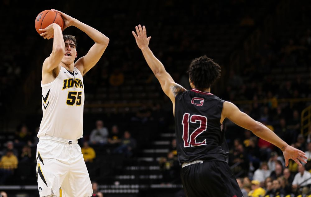 Iowa Hawkeyes forward Luka Garza (55) puts up a 3-pointer during a game against Guilford College at Carver-Hawkeye Arena on November 4, 2018. (Tork Mason/hawkeyesports.com)