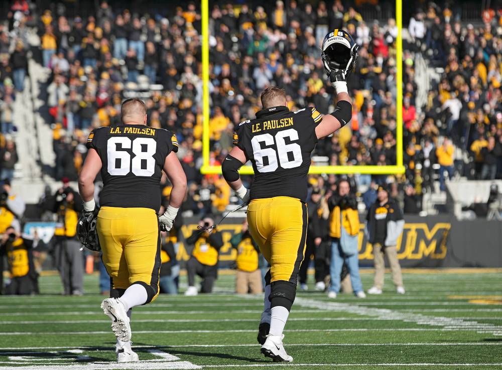 Iowa Hawkeyes offensive lineman Landan Paulsen (68) and offensive lineman Levi Paulsen (66) are acknowledged on senior day before their game at Kinnick Stadium in Iowa City on Saturday, Nov 23, 2019. (Stephen Mally/hawkeyesports.com)