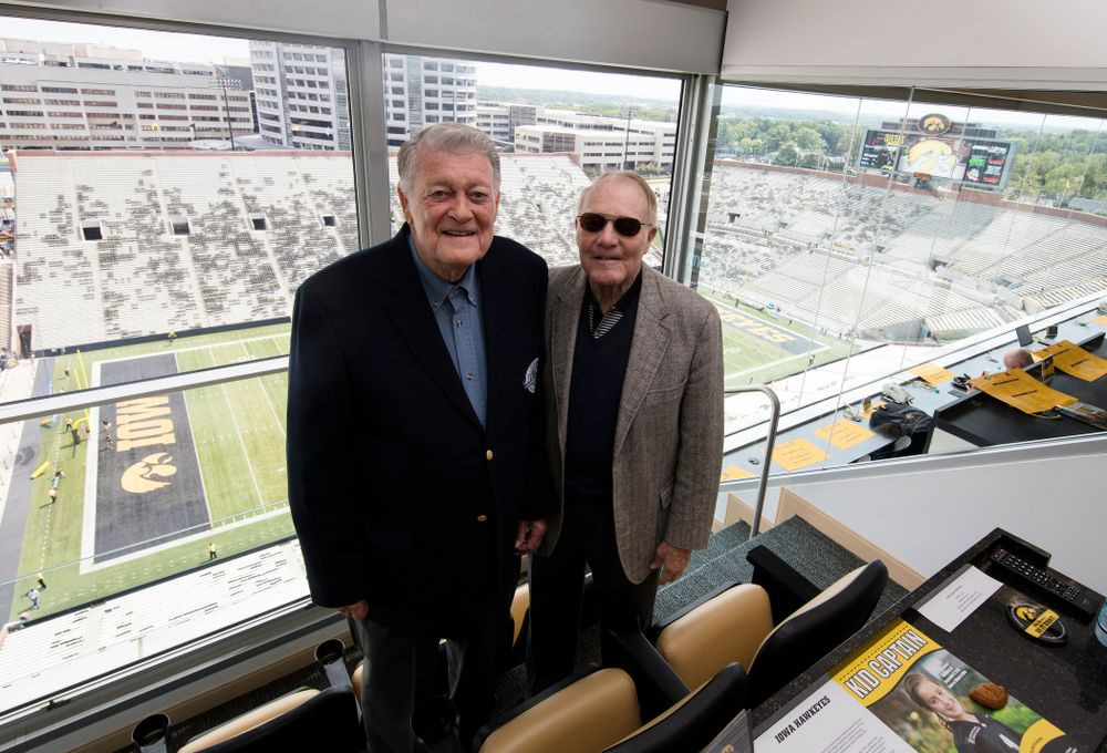 Former Iowa Hawkeyes head coach Hayden Fry and former athletics director Bump Elliott stands in the press box Saturday, September 3, 2016 at Kinnick Stadium. (Brian Ray/hawkeyesports.com)