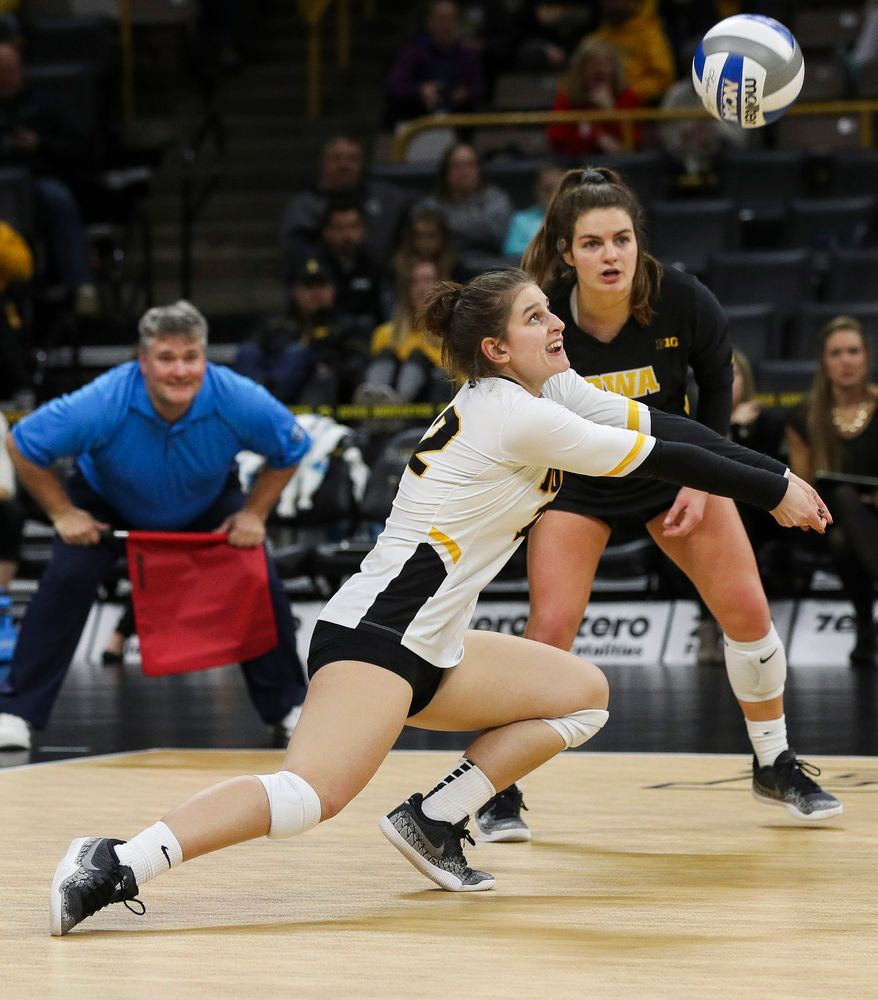 Iowa Hawkeyes defensive specialist Emily Bushman (12) digs the ball during a match against Maryland at Carver-Hawkeye Arena on November 23, 2018. (Tork Mason/hawkeyesports.com)