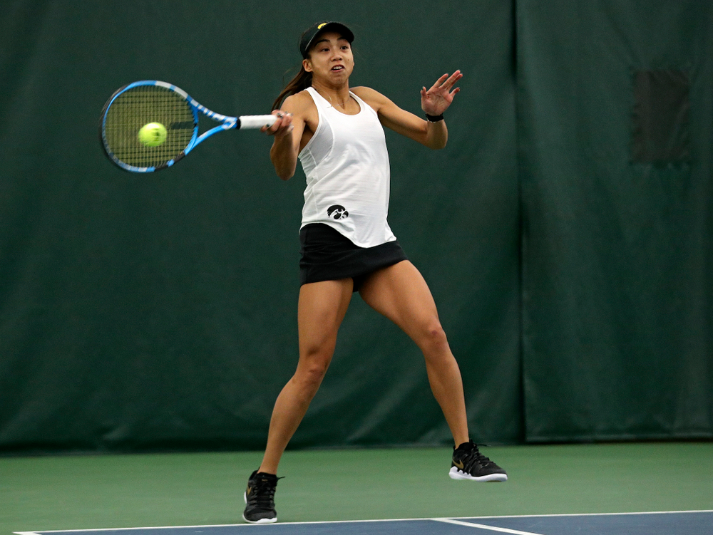 Iowa's Michelle Bacalla returns a shot during her doubles match at the Hawkeye Tennis and Recreation Complex in Iowa City on Sunday, February 23, 2020. (Stephen Mally/hawkeyesports.com)