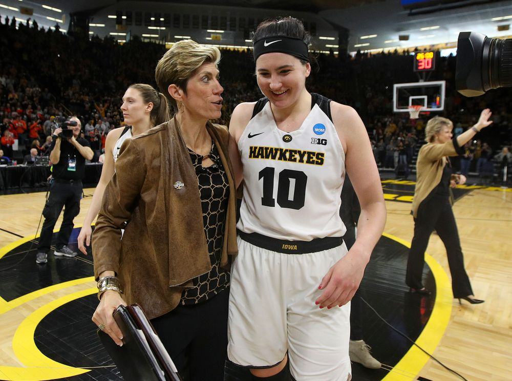 Iowa Hawkeyes associate head coach Jan Jensen and forward Megan Gustafson (10) talk as they walk off the court after winning their game during the first round of the 2019 NCAA Women's Basketball Tournament at Carver Hawkeye Arena in Iowa City on Friday, Mar. 22, 2019. (Stephen Mally for hawkeyesports.com)