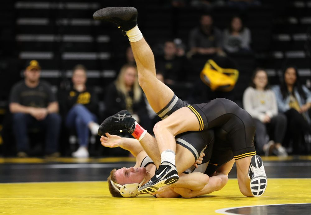 Iowa's Kaleb Young wrestles Purdue's Griffin Parriott at 157 pounds Saturday, November 24, 2018 at Carver-Hawkeye Arena. (Brian Ray/hawkeyesports.com)