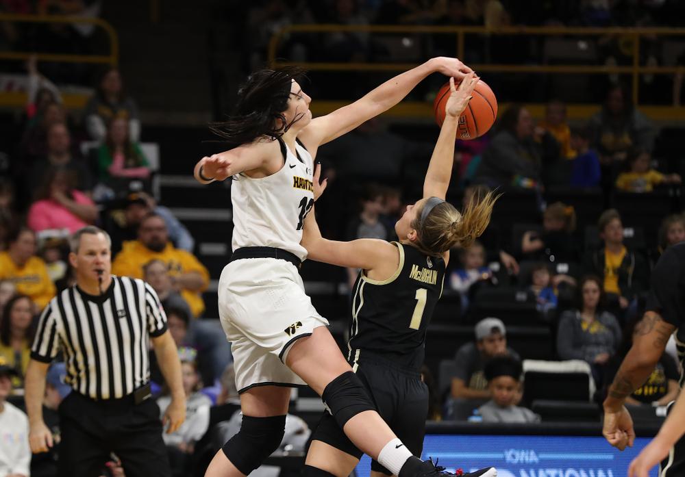 Iowa Hawkeyes forward Megan Gustafson (10) blocks a shot against the Purdue Boilermakers Sunday, January 27, 2019 at Carver-Hawkeye Arena. (Brian Ray/hawkeyesports.com)