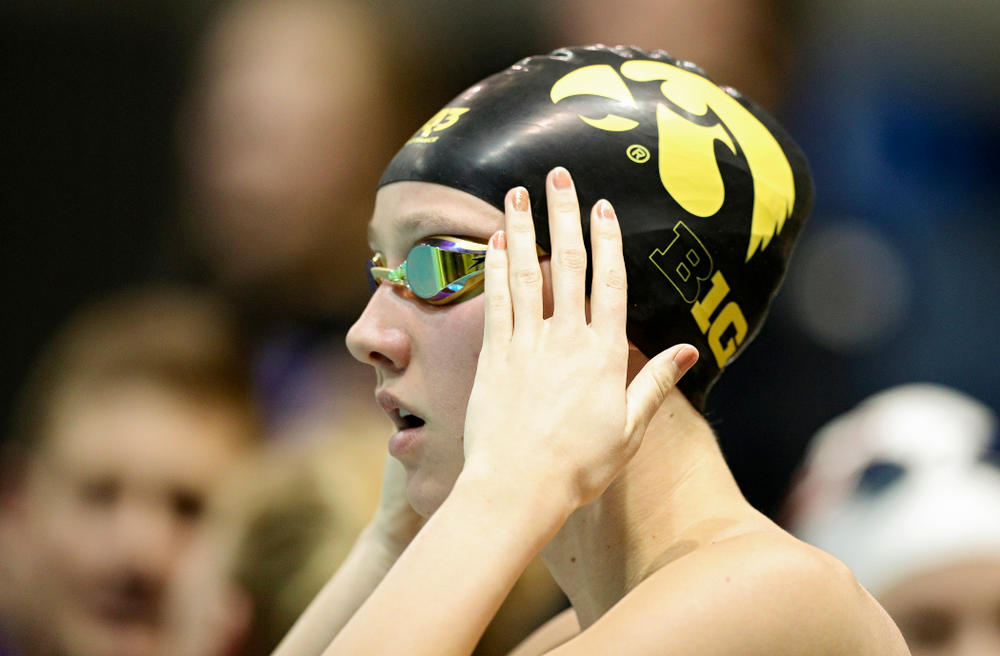 Iowa's Macy Rink adjusts her cap before swimming the women's 200 yard freestyle C final event during the 2020 Women's Big Ten Swimming and Diving Championships at the Campus Recreation and Wellness Center in Iowa City on Friday, February 21, 2020. (Stephen Mally/hawkeyesports.com)
