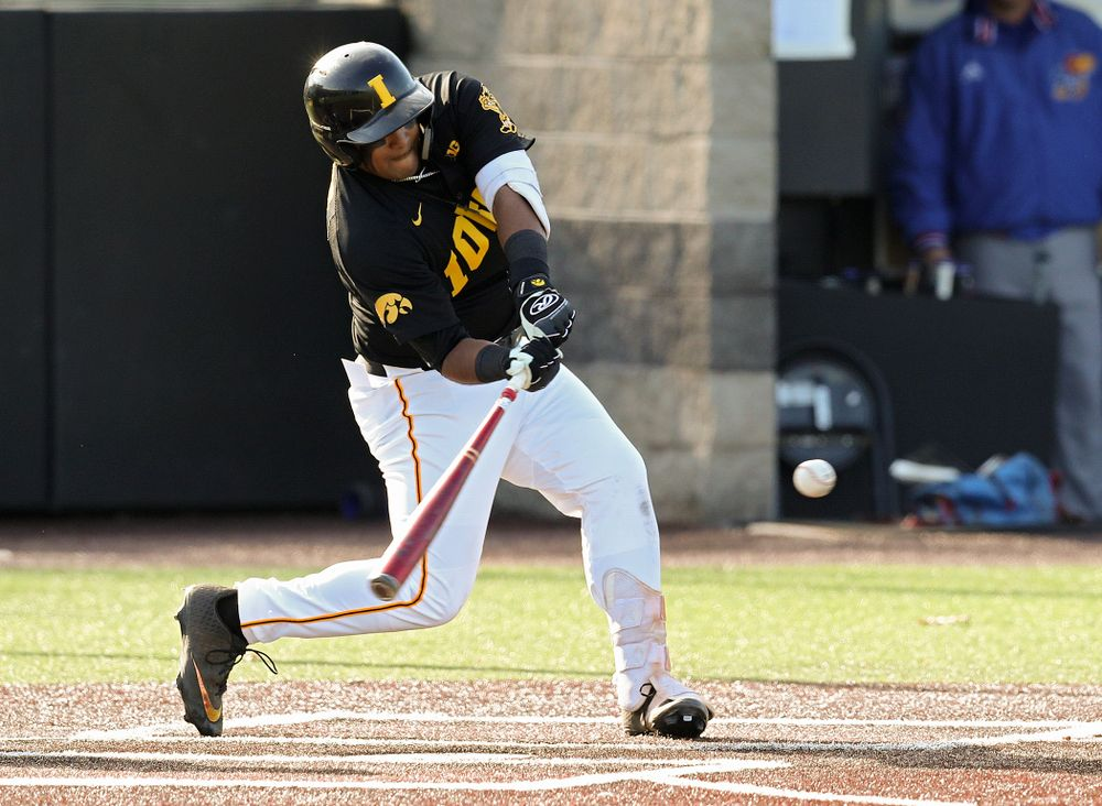 Iowa infielder Izaya Fullard (20) gets a hit during the first inning of their college baseball game at Duane Banks Field in Iowa City on Tuesday, March 10, 2020. (Stephen Mally/hawkeyesports.com)