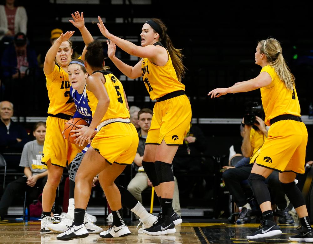 Iowa Hawkeyes guard Kathleen Doyle (22), Iowa Hawkeyes forward Megan Gustafson (10)