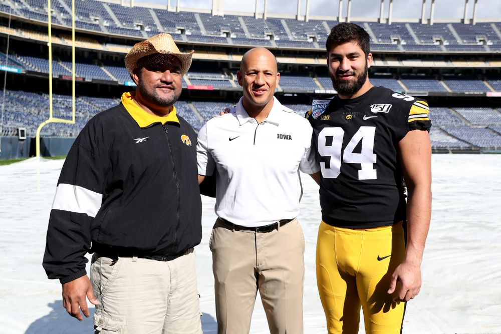 Eppy Epenesa, Iowa Hawkeyes special teams coordinator LeVar Woods, and defensive end A.J. Epenesa (94) following the team photo Wednesday, December 25, 2019 at SDCCU Stadium in San Diego. (Brian Ray/hawkeyesports.com)