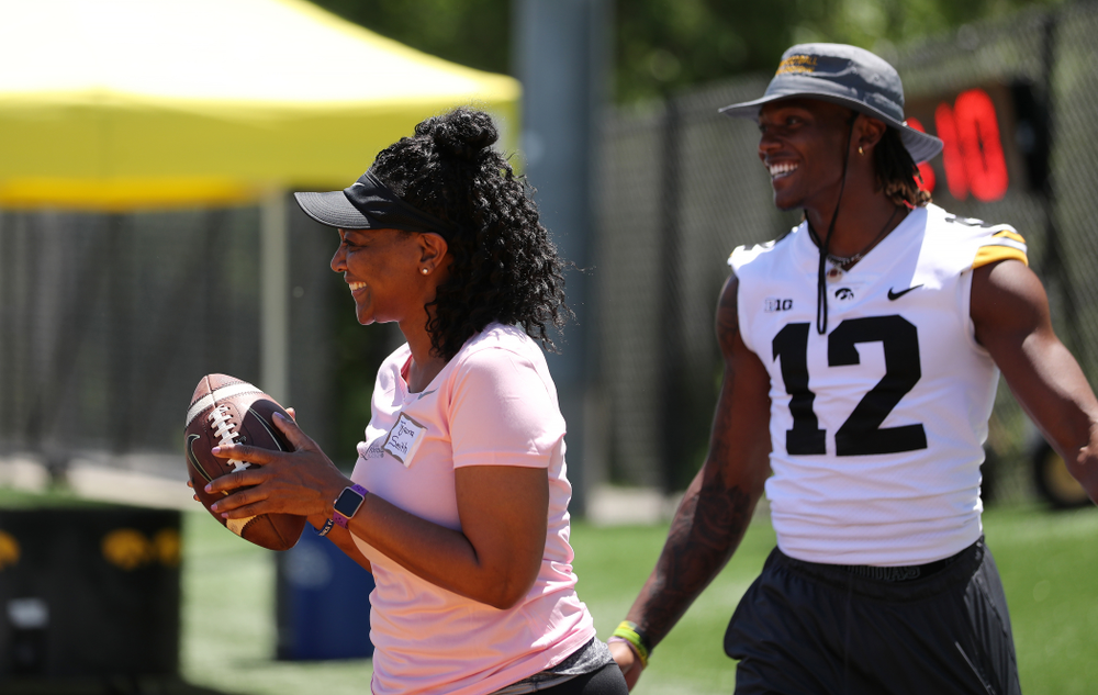 Tyjauna Smith makes a catch in front of her son, Iowa Hawkeyes wide receiver Brandon Smith (12), during the 2019 Iowa Ladies Football Academy Saturday, June 8, 2019 at the Hansen Football Performance Center. (Brian Ray/hawkeyesports.com)
