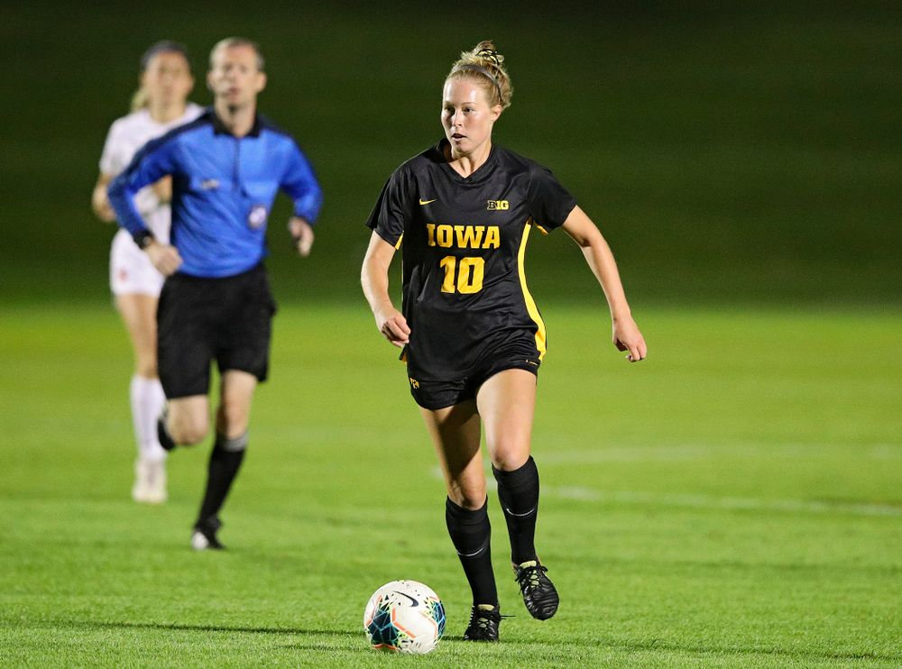 Iowa midfielder/defender Natalie Winters (10) looks down field as she moves with the ball during the first half of their match against Illinois at the Iowa Soccer Complex in Iowa City on Thursday, Sep 26, 2019. (Stephen Mally/hawkeyesports.com)