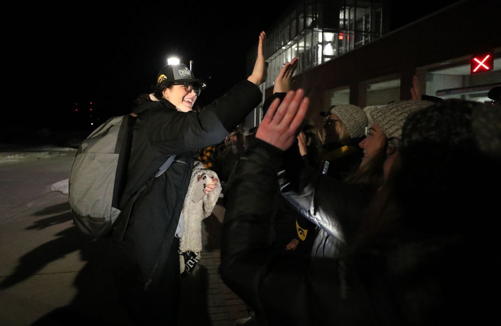 Iowa Hawkeyes forward Megan Gustafson (10) celebrates with fans as they arrive back in Coralville after defeating the Maryland Terrapins in the Big Ten Championship Game Sunday, March 10, 2019 in Indianapolis, Ind. (Brian Ray/hawkeyesports.com)