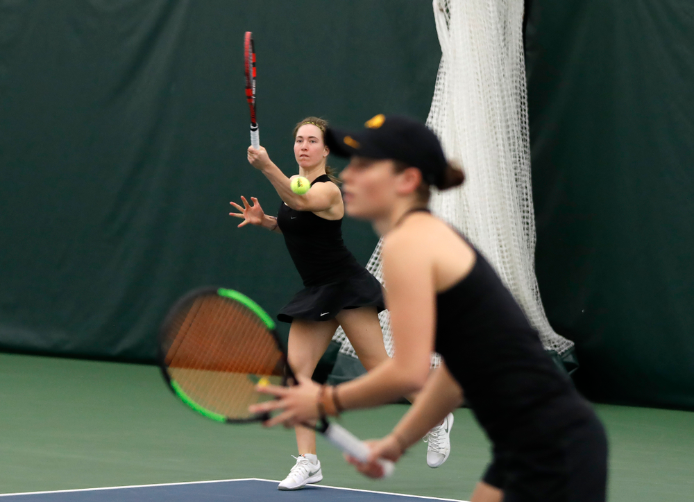 Elise Van Heuvelen and Anastasia Reimchen play a doubles match against Ohio State Sunday, March 25, 2018 at the Hawkeye Tennis and Recreation Center. (Brian Ray/hawkeyesports.com)