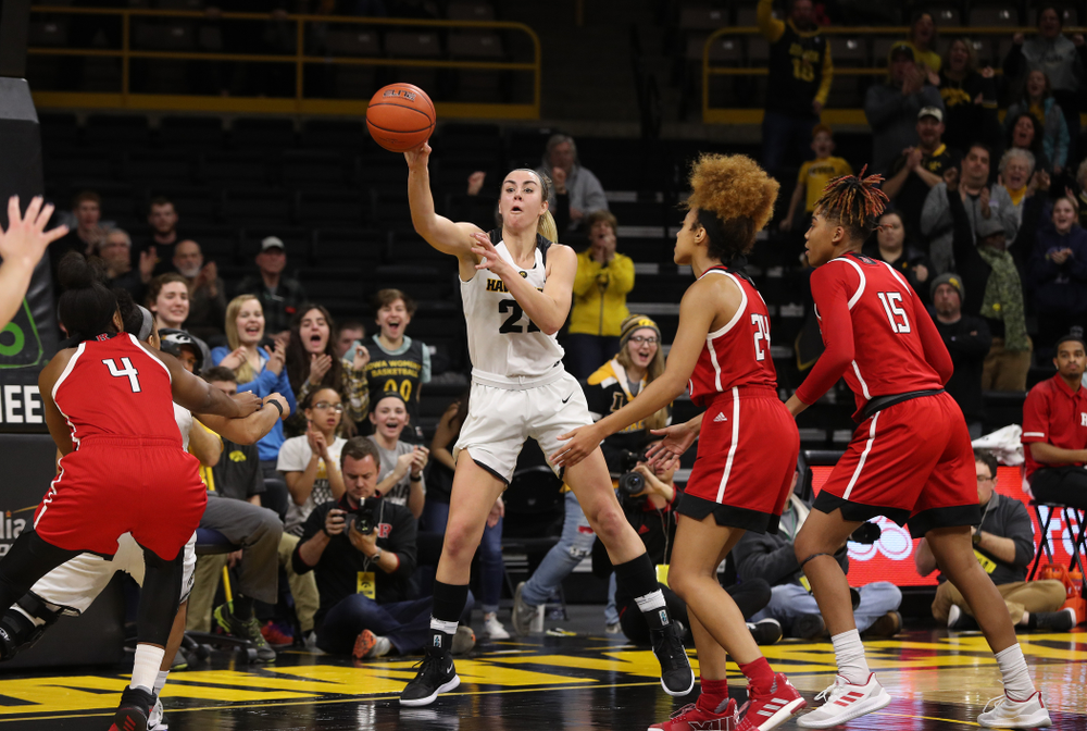 Iowa Hawkeyes forward Hannah Stewart (21) kicks the ball out after getting a block and a steal against the Rutgers Scarlet Knights Wednesday, January 23, 2019 at Carver-Hawkeye Arena. (Brian Ray/hawkeyesports.com)