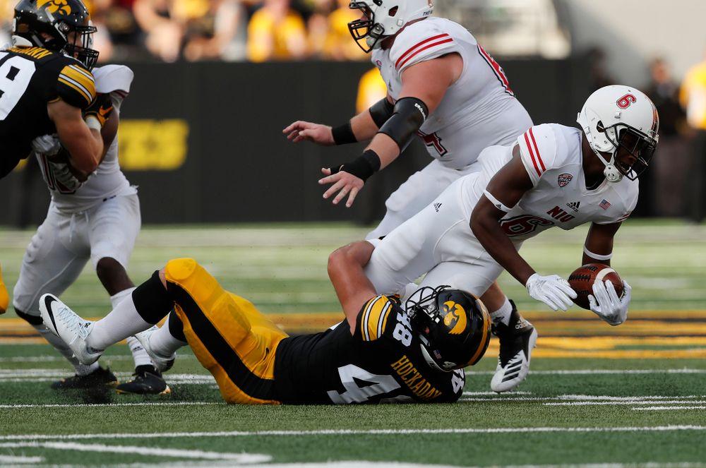 Iowa Hawkeyes linebacker Jack Hockaday (48) brings down Northern Illinois Huskies quarterback Rodney Hall (6) Saturday, September 1, 2018 at Kinnick Stadium. (Brian Ray/hawkeyesports.com)