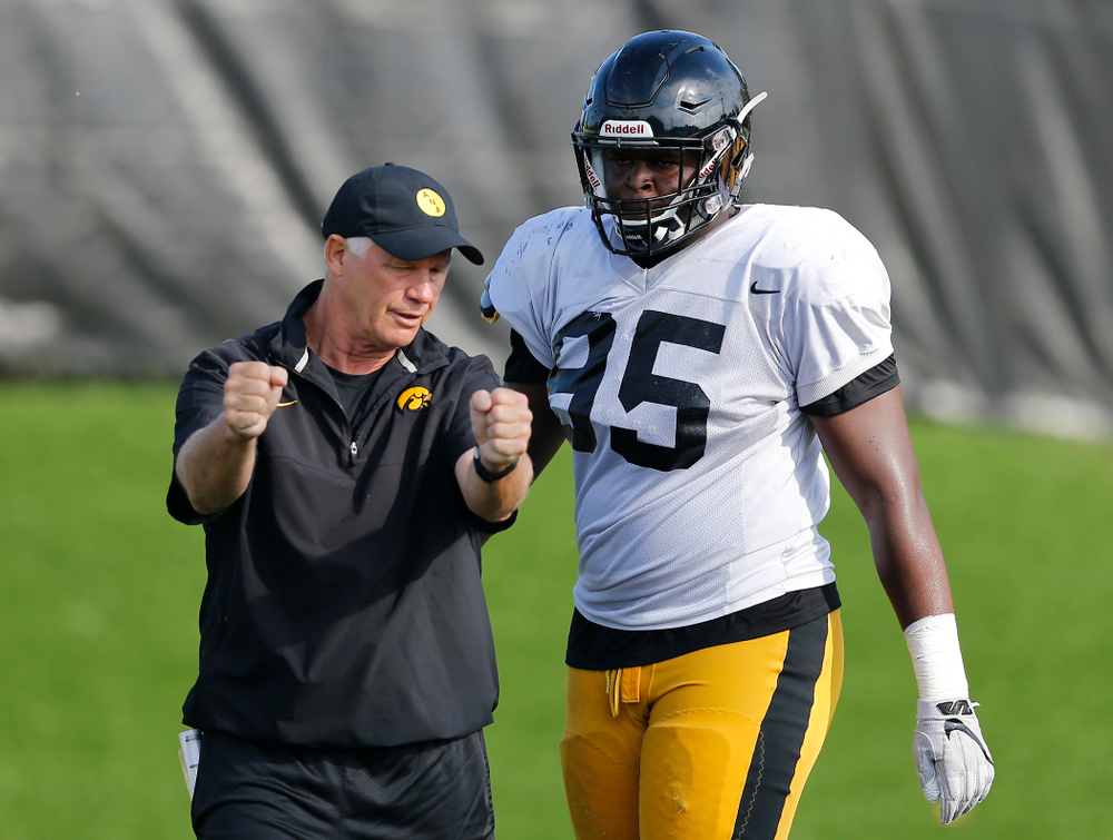 Iowa Hawkeyes defensive line coach Reese Morgan works with defensive end Cedrick Lattimore (95) Wednesday, August 17, 2016 at the Hansen Football Performance Center. (Brian Ray/hawkeyesports.com)