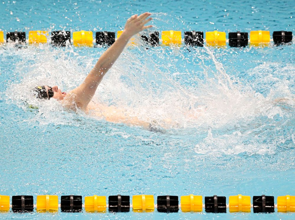 Iowa's Jacob Rosenkoetter swims the men's 50 yard backstroke event during their meet at the Campus Recreation and Wellness Center in Iowa City on Friday, February 7, 2020. (Stephen Mally/hawkeyesports.com)