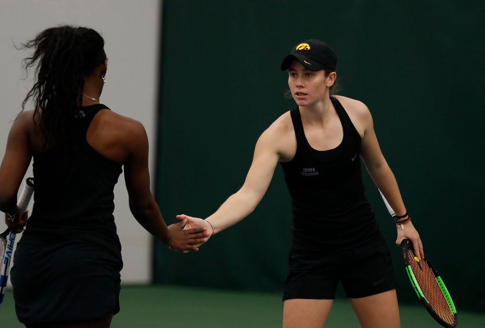 Iowa's Adorabol Huckleby and Elize Van Heuvelen play a doubles match against Marquette
