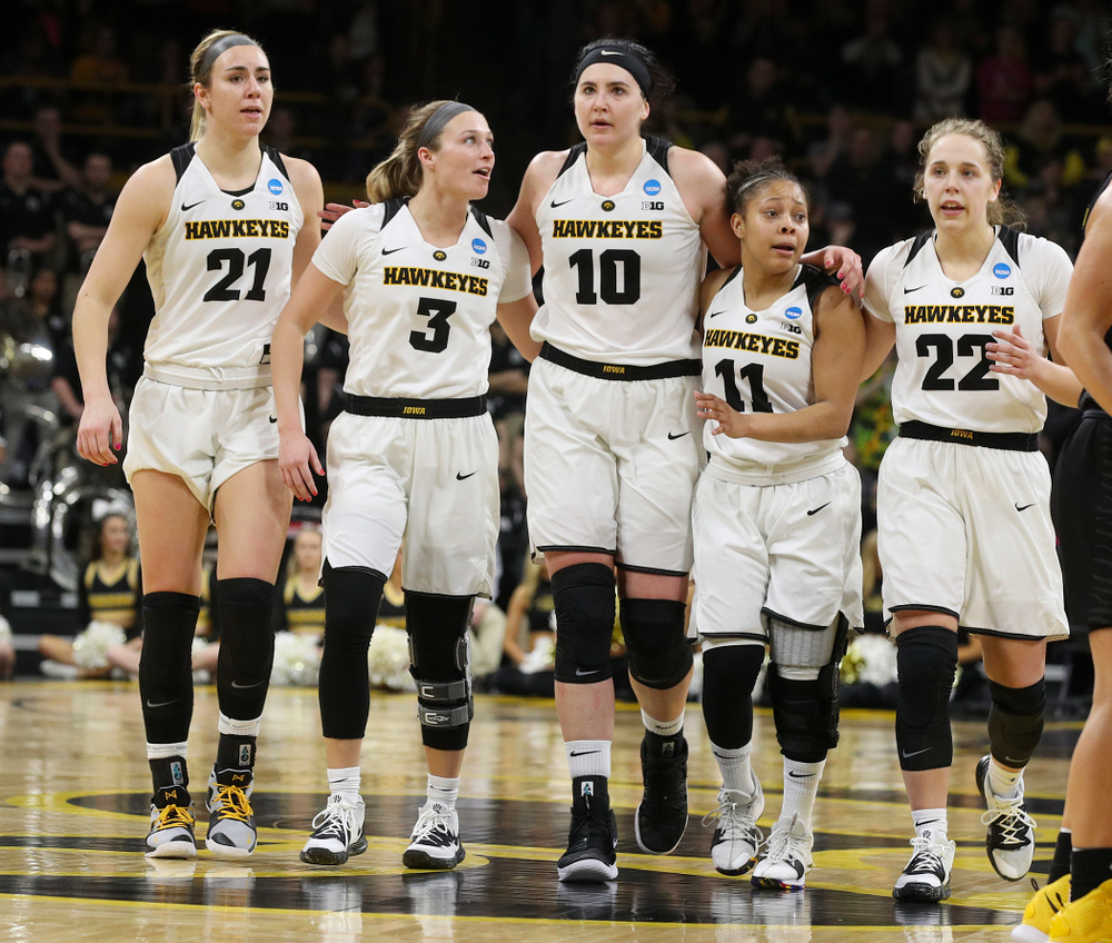 Iowa Hawkeyes forward Hannah Stewart (21), guard Makenzie Meyer (3), center Megan Gustafson (10), guard Tania Davis (11), and guard Kathleen Doyle (22) walk down the court together during the fourth quarter of their second round game in the 2019 NCAA Women's Basketball Tournament at Carver Hawkeye Arena in Iowa City on Sunday, Mar. 24, 2019. (Stephen Mally for hawkeyesports.com)