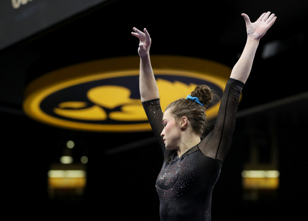 Iowa's Mackenzie Vance competes on the beam against Michigan Friday, February 14, 2020 at Carver-Hawkeye Arena. (Brian Ray/hawkeyesports.com)