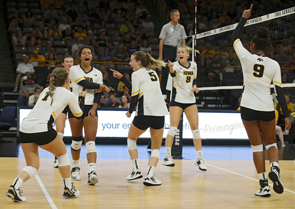 Iowa's Joslyn Boyer (1), Halle Johnston (4), Brie Orr (7), Meghan Buzzerio (5), Kyndra Hansen (8), and Amiya Jones (9) celebrate a score during their Big Ten/Pac-12 Challenge match at Carver-Hawkeye Arena in Iowa City on Saturday, Sep 7, 2019. (Stephen Mally/hawkeyesports.com)